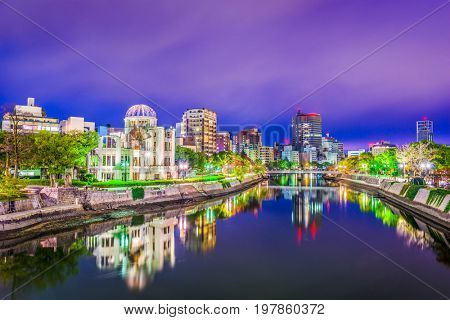 Hiroshima, Japan skyline and Peace Memorial Park at night.