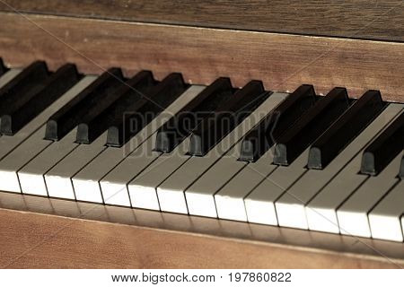 Vintage old piano with keys for music ebony and ivory
