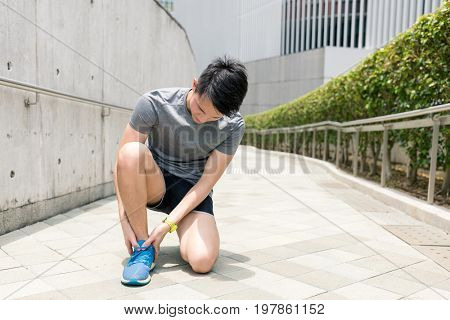 Sport man getting hurt on legs