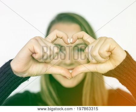 Happiness woman in love forming heart love hand sign