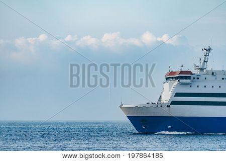 an industrial ship cruising on bohai ocean against blue sky,dalian city,china.