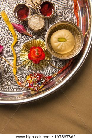 A Rakhi - traditional Indian wrist band placed in a decorative pooja thali.