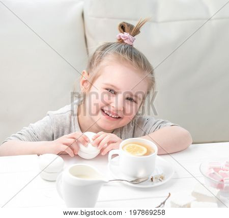 Little girl with sweets around her