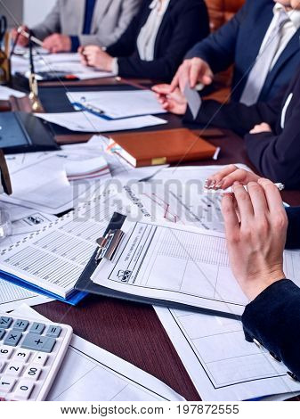 Business people office life of team people working with papers sitting table. Schemas and diagrams close up. Work of accountant. Calculation of expenses for the year.