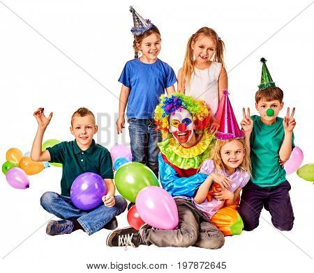 Birthday child clown playing with children and bunny fingers prank. Kid holiday cakes celebratory and balloons the happiest birthday. Morning in the kindergarten. Holiday for children in kindergarten.