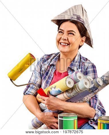 Repair home elderly woman holding paint roller for wallpaper. Senior woman in newspaper cap renovation apartment and glad to choose right materials on isolated. Female took a loan for repairs.