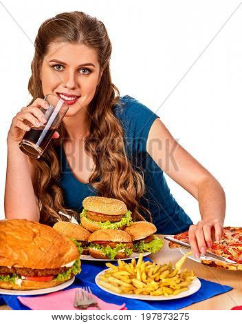 Woman eating french fries and hamburger. Student consume fast food on table. Girl drinks cola and dreams. Girl trying to eat junk. Advertise fast food on isolated. Student eats semi-finished products.