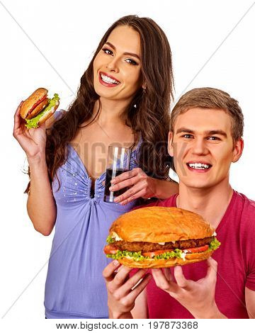 Couple eating fast food. Man and woman treat big hamburger with ham. Friends give burder junk on white background isolated. Food semi-finished products. How to feed the husband.