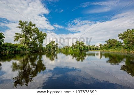 summer scene on river with nice clouds in sky