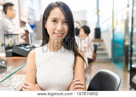Woman holding small business in optician store