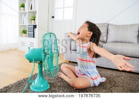 Happy Female Kid Opening Arms Enjoying Cool Wind