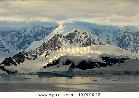 Antarctica landscape, icebergs, mountains and ocean at sunrise, Antarctica
