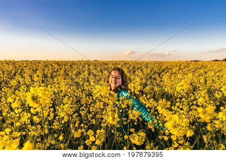 Teenage Girl With Long Hair In Yellow Bittercress Field