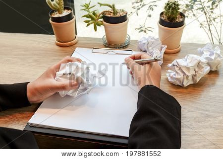 Hands of business woman crumple resume at the desk mistake document - failure business concept