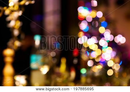 Unsharp Bokeh background during new years party with colorful lights