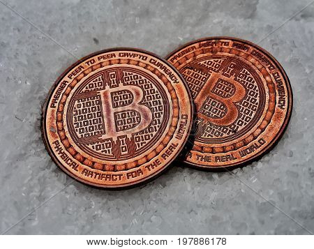 Two Very Old Brass Bitcoins