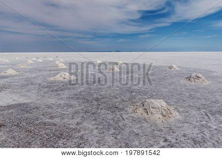 Drying hand- shoveled salt piles at Salar de Uyuni Bolivia