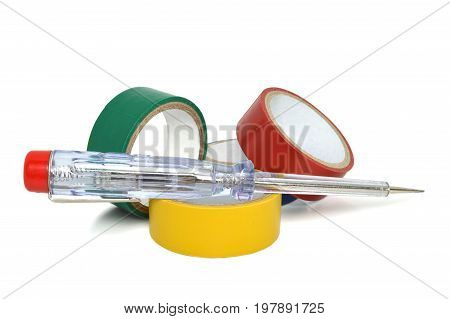 Insulating tapes and screwdriver isolated on white background