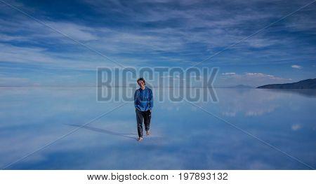 Uyuni, Bolivia- March 25, 2017:Man walking on the lake Salar de Uyuni Bolivia