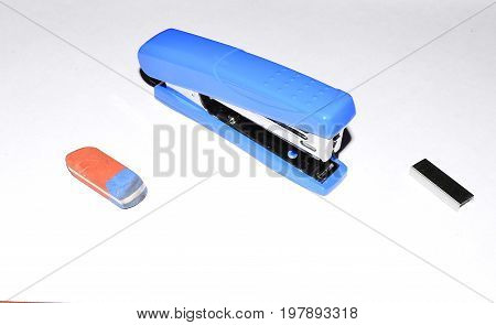 Eraser, stapler and staples as a set of stationery items for office on white background