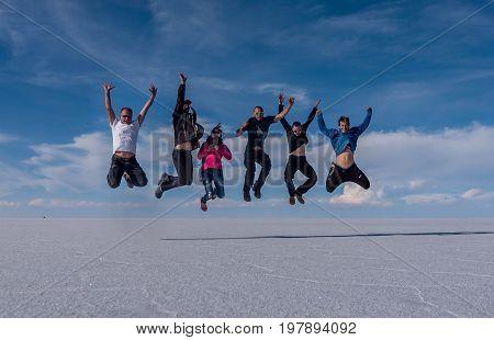 Uyuni, Bolivia- March 25, 2017: People jumping on the lake Salar de Uyuni Bolivia