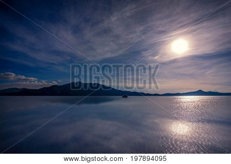 Off- road car on lake Salar de Uyuni Bolivia