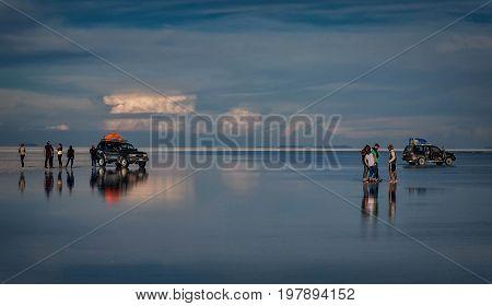 Uyuni, Bolivia- March 25, 2017:People standing on the lake reflection in  Salar de Uyuni Bolivia