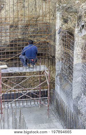 Worker Adding The Rebar For Support