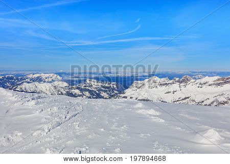 Wintertime view from Mt. Titlis in Switzerland. The Titlis is a mountain located on the border between the Swiss cantons of Obwalden and Bern mainly accessed from the town of Engelberg on the northern side.