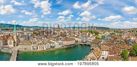 Zurich city center panorama with famous Fraumunster church St. Peter church and river Limmat - view from Grossmunster church on a sunny day with clouds in summer Canton of Zurich Switzerland