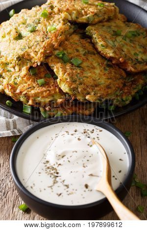 Delicious Snack: Zucchini Fritters With Sour Cream Close-up. Vertical