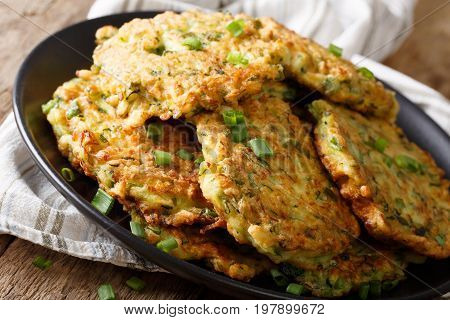 Hot Zucchini Fritters With Green Onions On A Plate Close-up. Horizontal