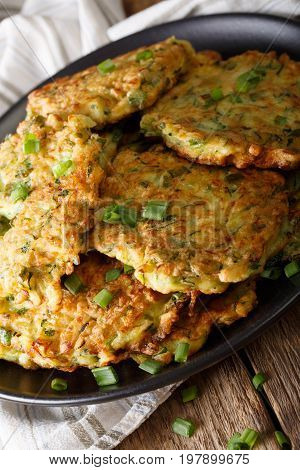 Zucchini Fritters With Green Onion On A Plate Close-up. Vertical