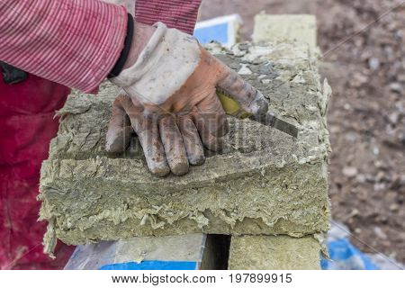 Cutting Mineral Wool Panel With A Craft Knive