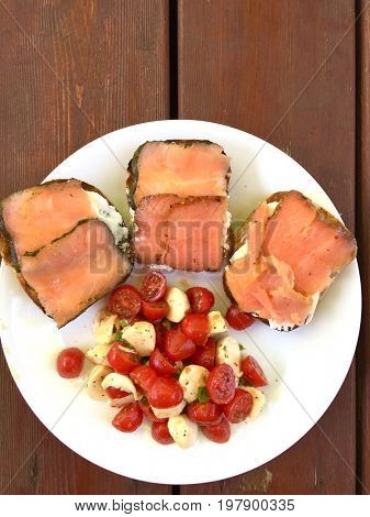 Delicious and fresh breakfast. Smoked salmon, tomatoes and white cheese.