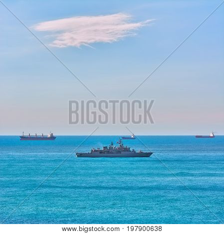 Military Frigate near Cargo Ships in the Black Sea