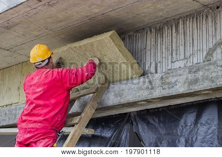 Man Installing External Wall Insulation