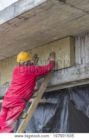 Man Installing External Wall Insulation 3
