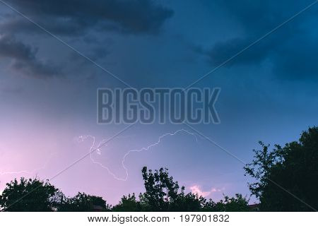 Night storm in the sky above summer landscape