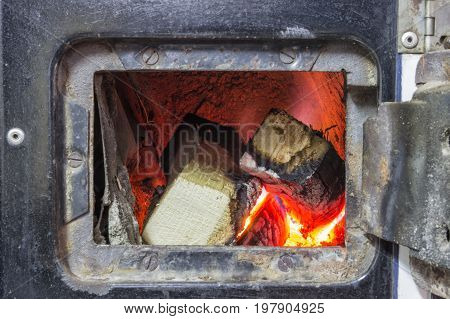 Wood Stove Firebox With Fire And Wood