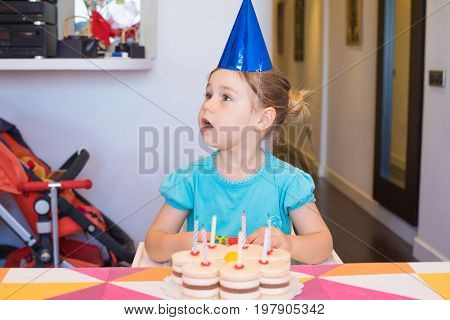 Child With Birthday Cake Looking Side