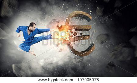 Karate man attack euro. Mixed media