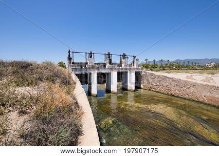 Open Sluices In Waterway River In Castellon