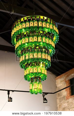 July 29th, 2017, Distillers Walk, Midleton, Co Cork, Ireland - Chandelier made out of bottles inside the Jameson Experience, an Irish whiskey museum and visitor centre located in the Old Midleton Distillery in Midleton