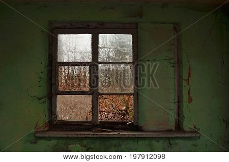 Old broken window with old painted green wall
