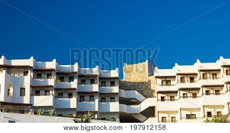 View of the hotel with balconies. A typical building in the city of Bodrum, Turkey.