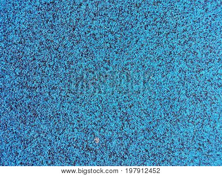 blue and black speckled very soft rubber ground
