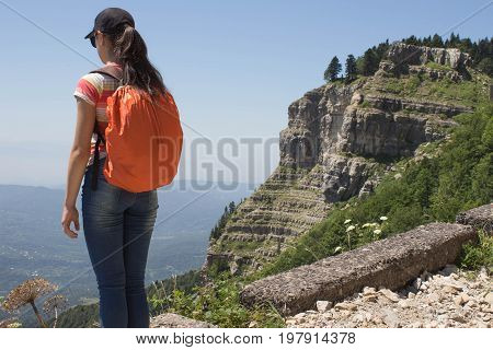 Active hiker. Traveler travel on the artificial roadway of the mountains reserve. Active and healthy lifestyle on summer vacation and weekend tour