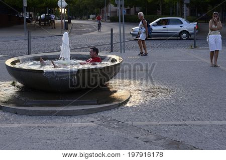 Celakovice, Czech Republic, 6 August, 2015, Editorial photo of man who is take a rest in fountain during hot summer, Celakovice, Czech Republic