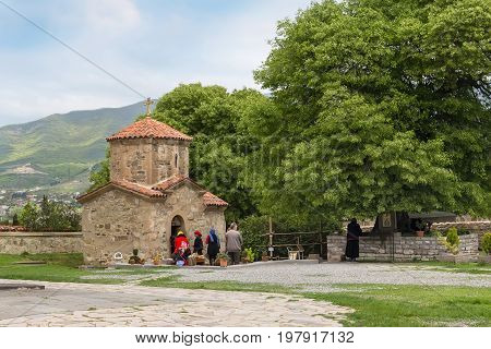 Mtskheta, Georgia - 8 October, 2016: Samtavro Monastery, small chapel and people